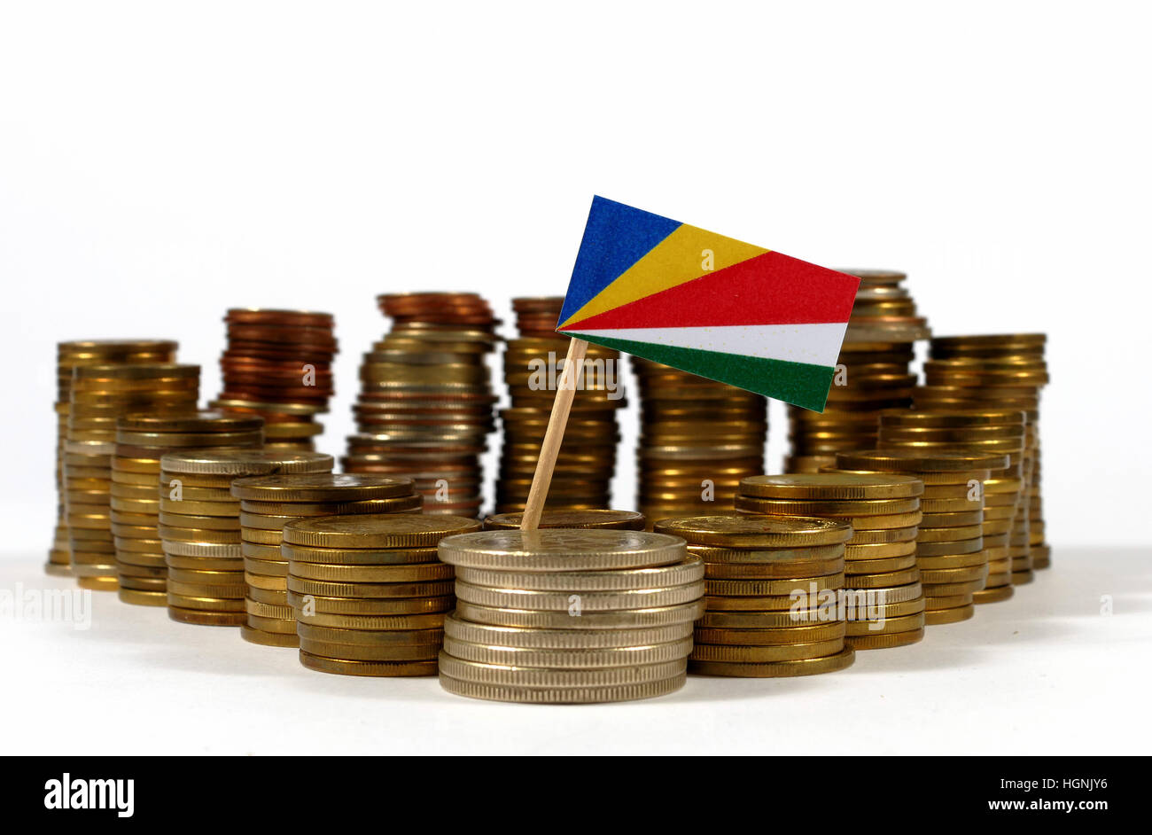 Seychelles flag waving with stack of money coins - Stock Image
