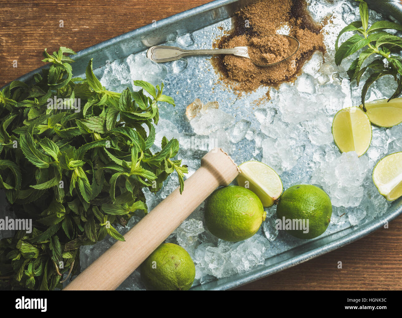 Ingredients for making mojito summer cocktail on ice in tray - Stock Image