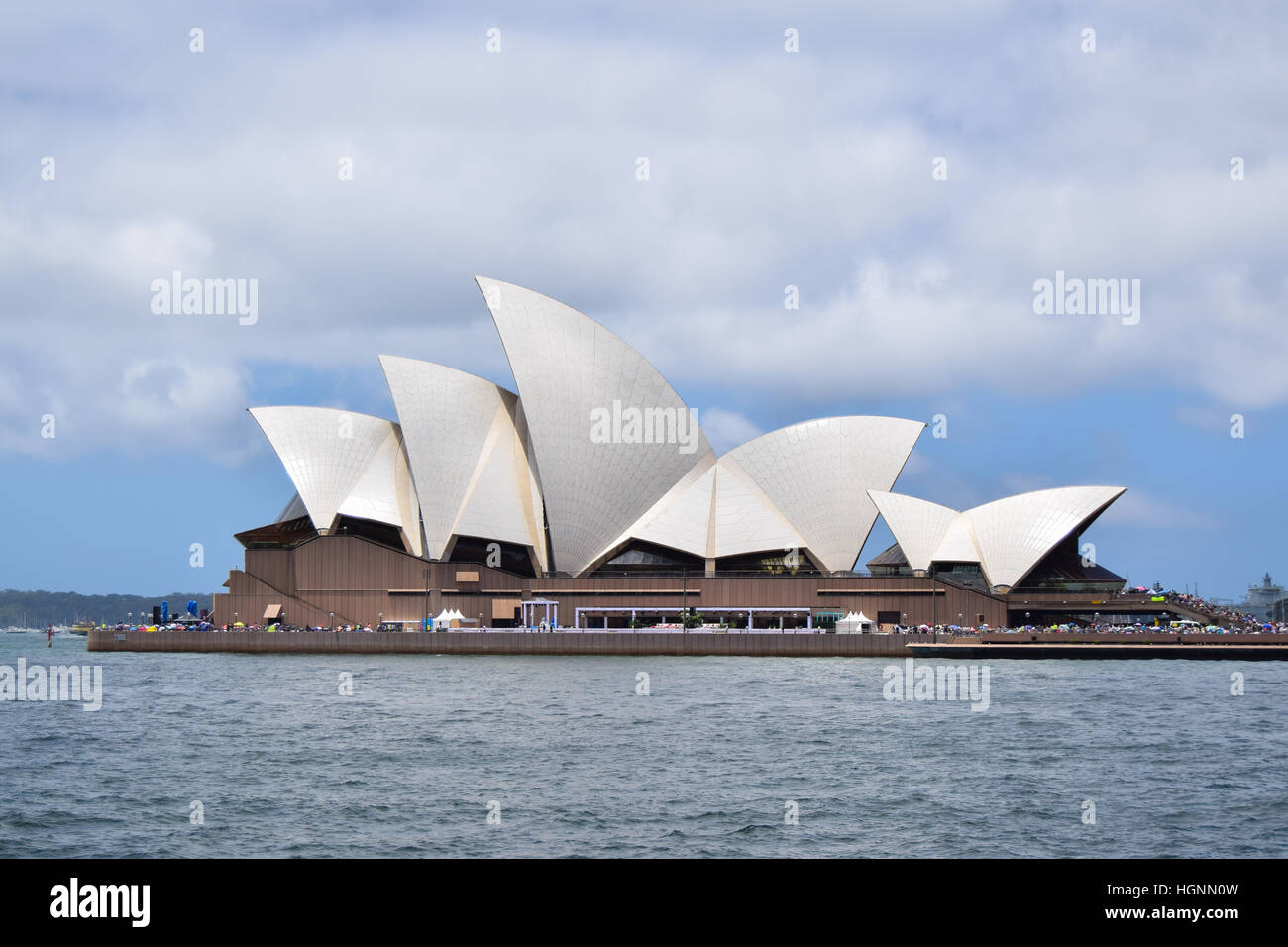 The Sydney Opera House SOH on Bennelong Point next to the Sydney Harbor Bridge and Harbor in Australia, New South Stock Photo