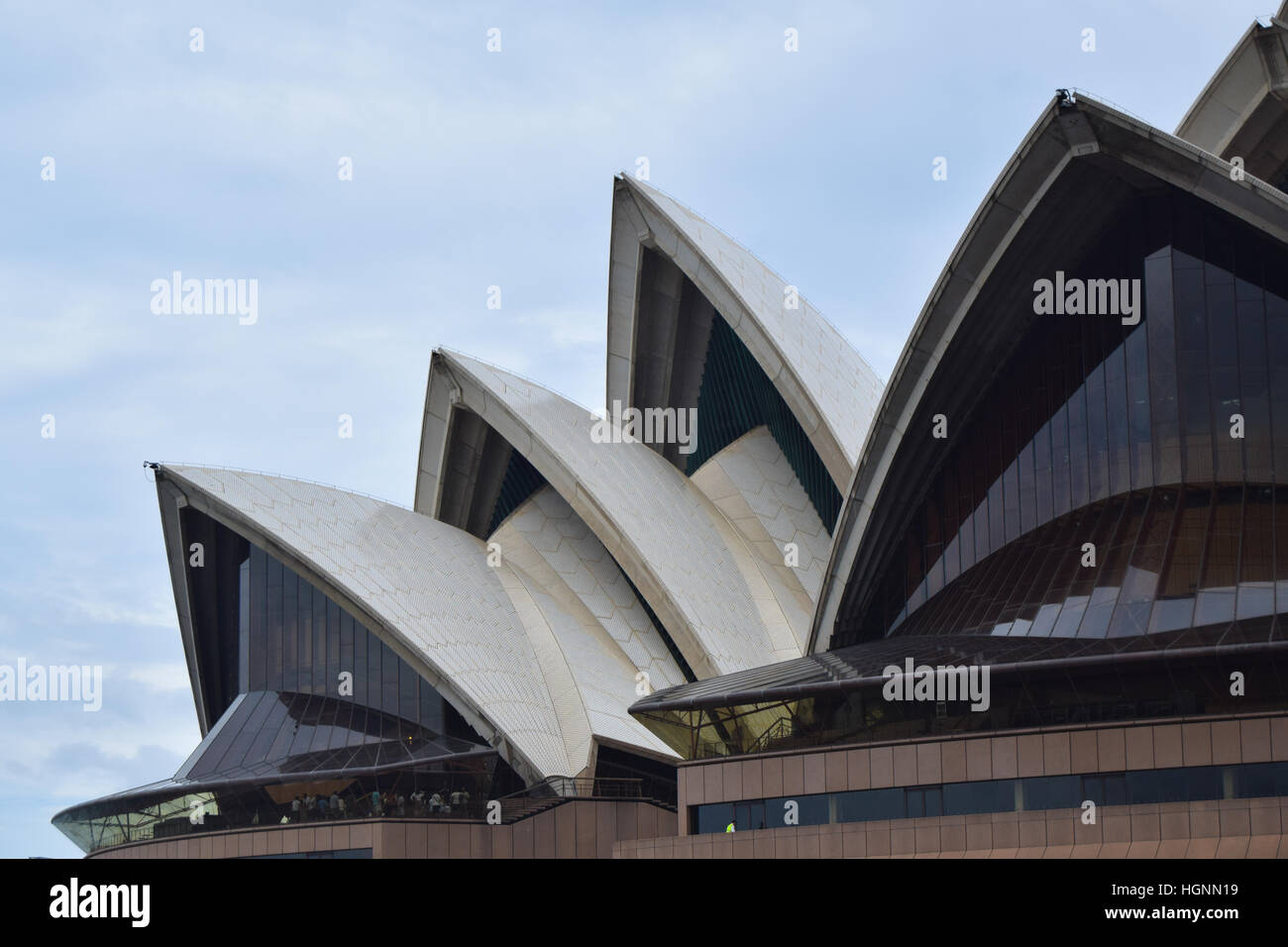 The Sydney Opera House SOH on Bennelong Point next to the Sydney Harbor Bridge and Harbor in Australia, New South - Stock Image