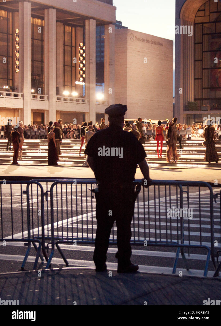 New York Police Officer watching the opening of a Fashion show during New York Fashion Week - Stock Image