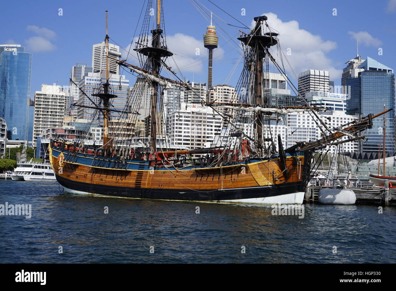 Ship in Darling Harbor, Sydney, Australia with the Sydney Tower Eye in the background. - Stock Image