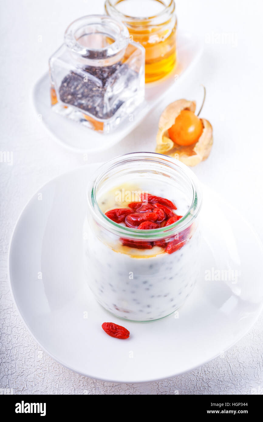 Yoghurt with goji berries, chia seeds and honey. - Stock Image