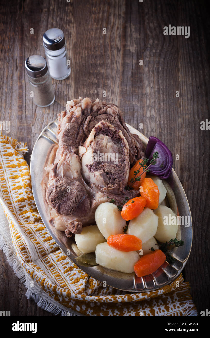 Pot-Au-Feu - French beef stew on a wooden surface Stock Photo