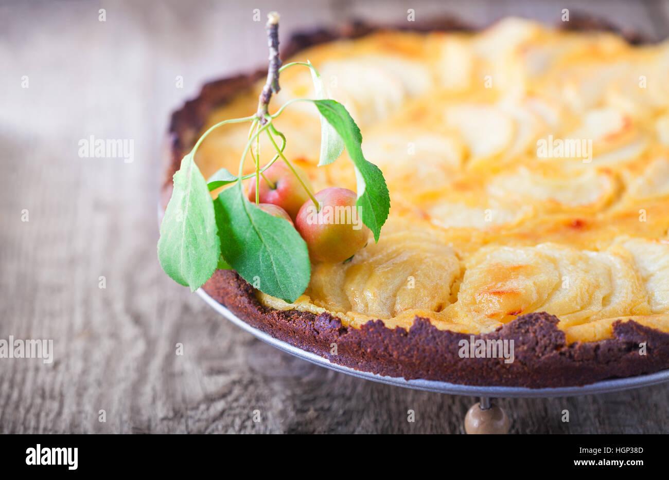 Apple pie with custard on wooden table. Gluten free. - Stock Image