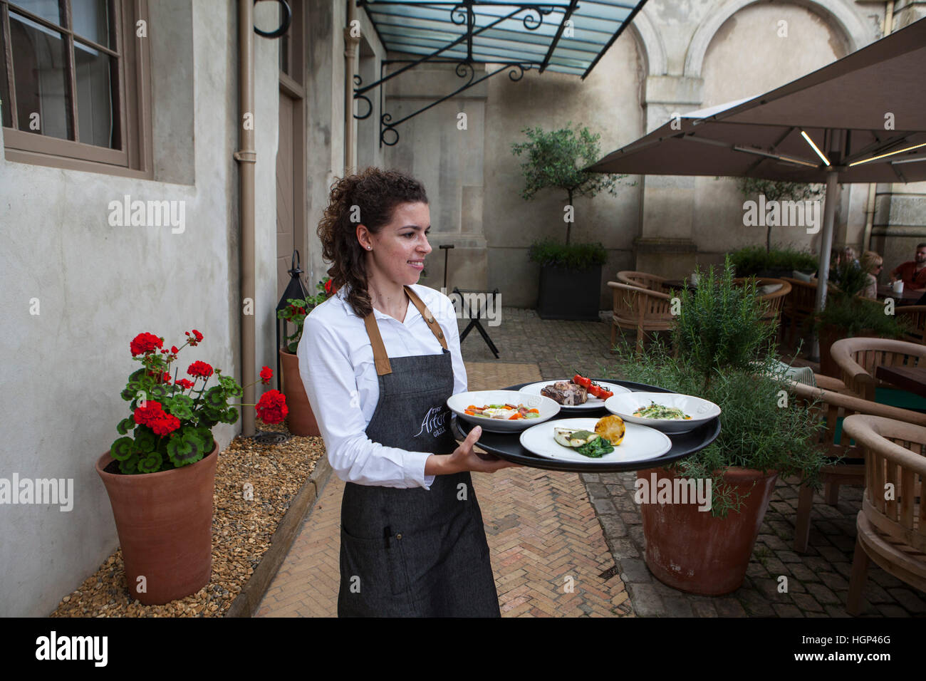 The Patio section of the Restaurant at The Astor Grill. - Stock Image