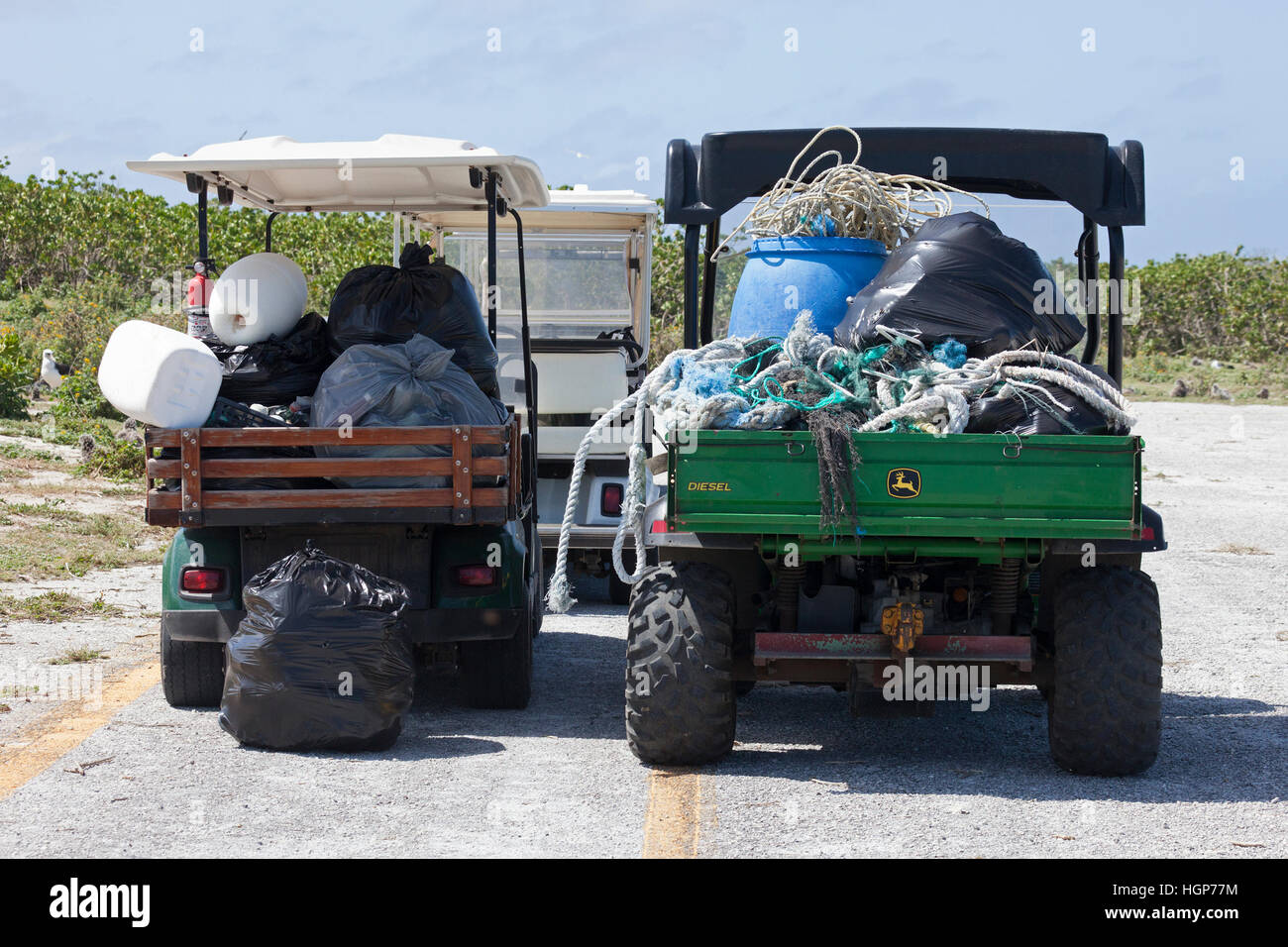 Marine debris collected from island shores by volunteers to prevent plastic, ropes and nets from harming wildlife - Stock Image