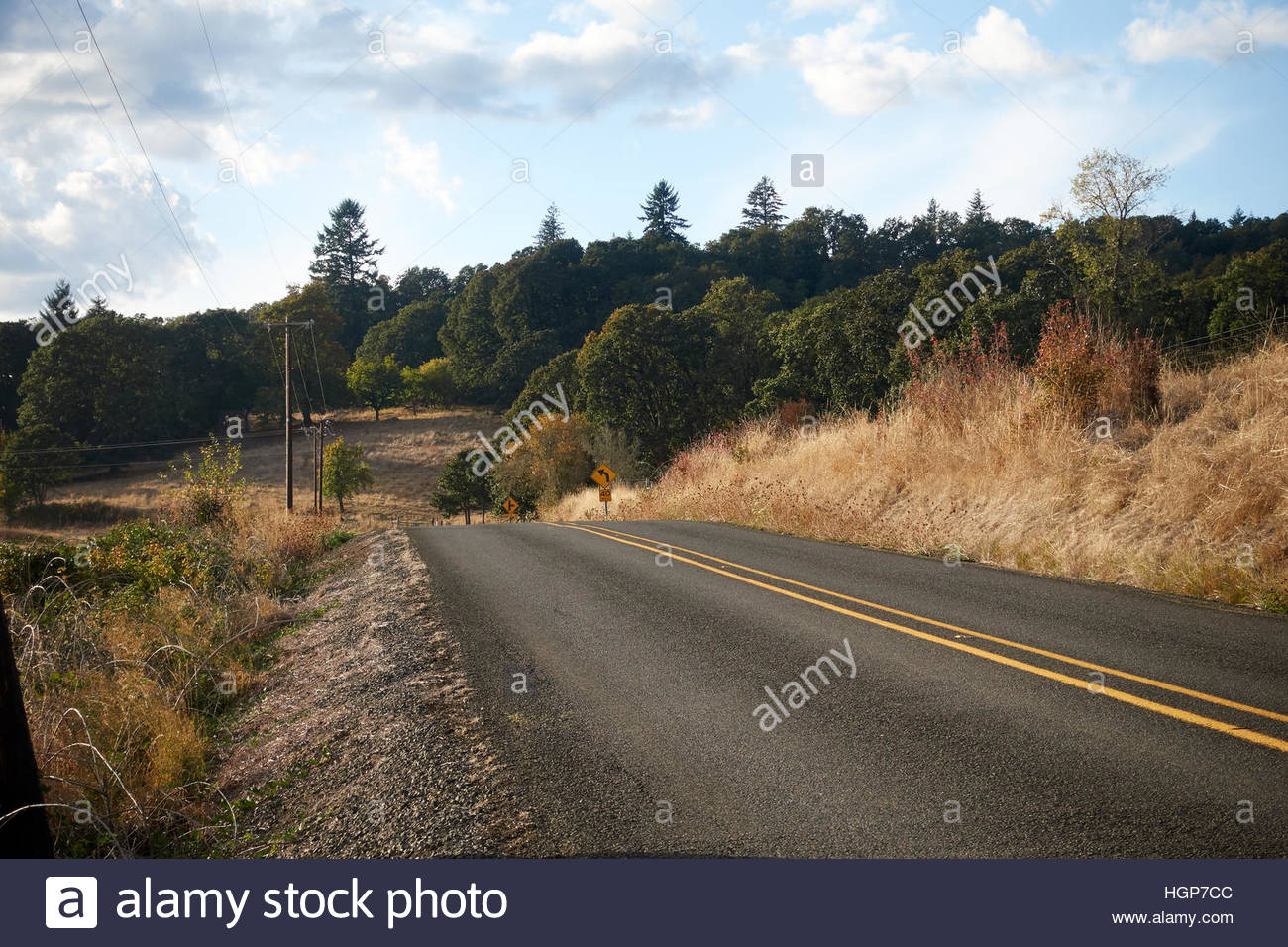 long distance bicyclists riding on a Oregon highway - Stock Image