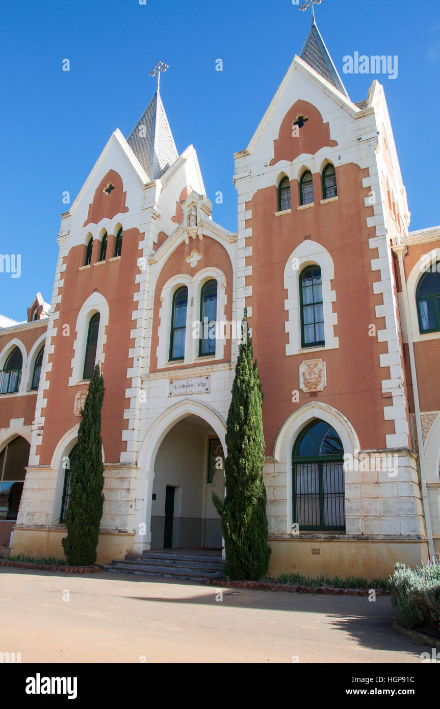 Front facade and entranceway to St. Gertrude's College with brick gothic architecture in New Norcia, Western - Stock Image