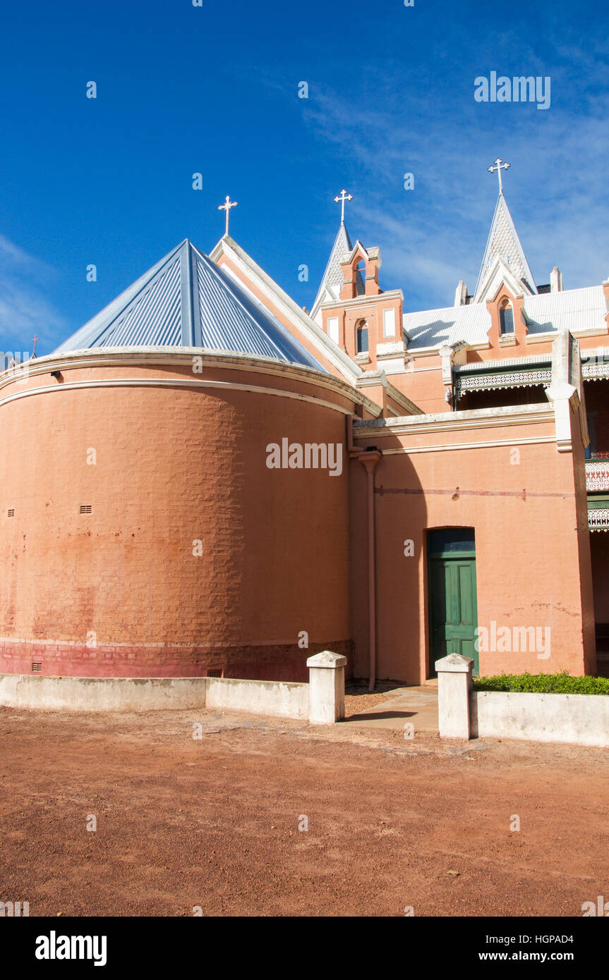 Rear view of St. Gertrude's College with brick architecture and cross details in gothic style in New Norcia, Western Stock Photo