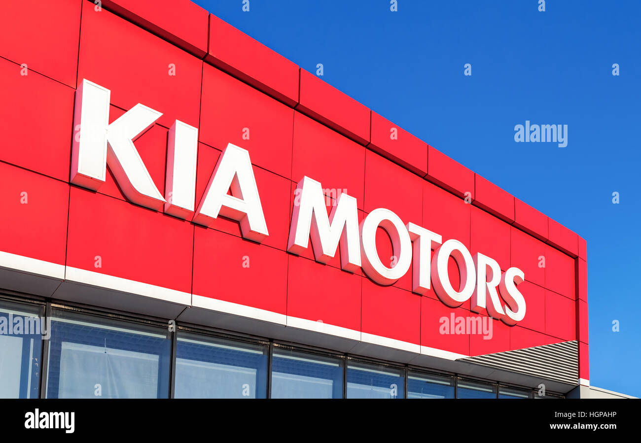 The emblem KIA motors on the office of official dealer - Stock Image