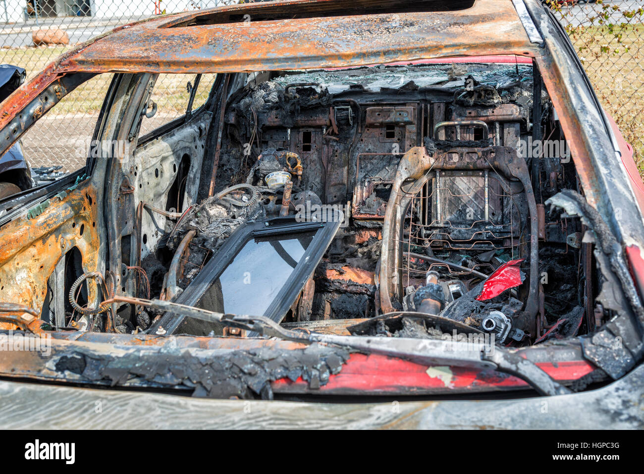 The charred interior of an automobile that was totally destroyed by a car fire.  Arson was suspected, but not proved. - Stock Image
