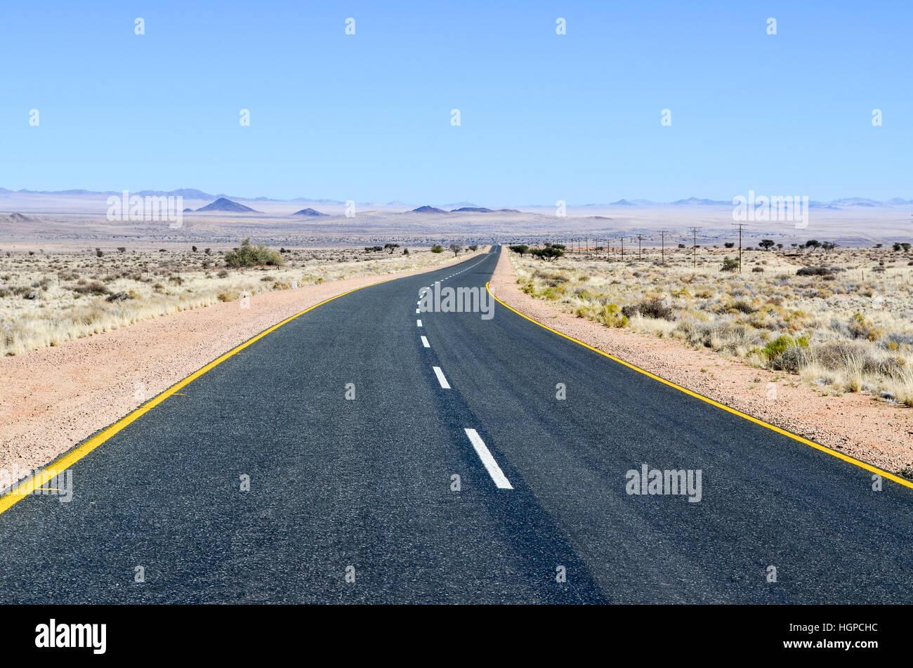 Desert road near Aus, in the Namib Desert, Namibia, Africa - Stock Image