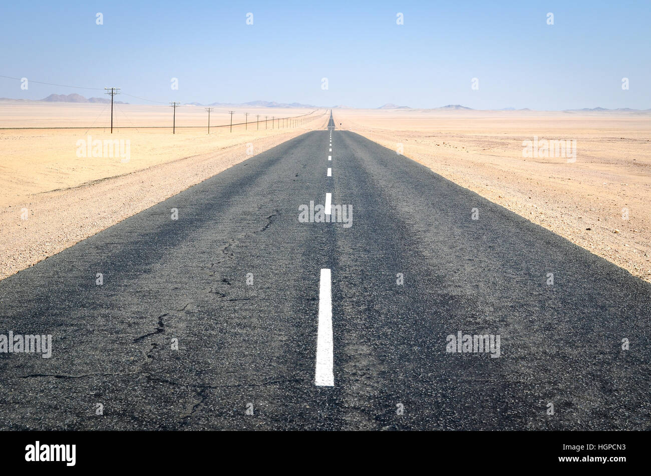 Electric lines along the road between Aus and Luderiz, Namibia - Stock Image