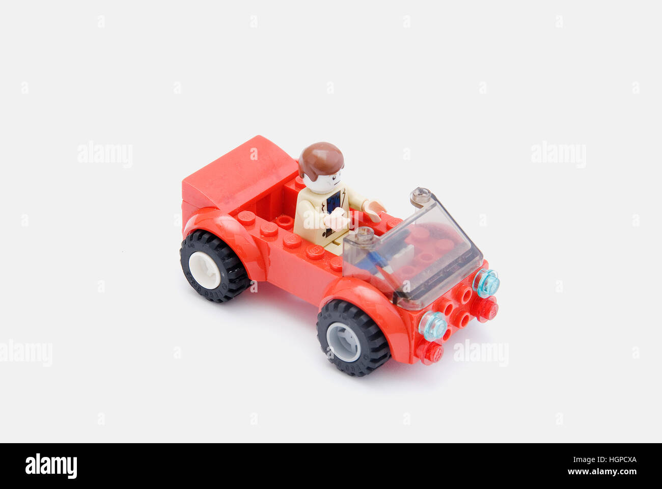 Mini figure Lego driving a car - Stock Image