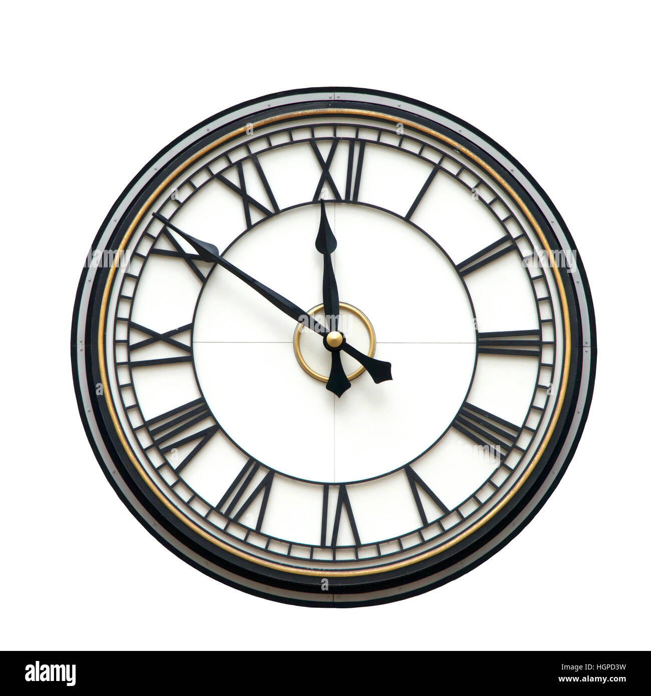 Clock with roman numerals for hours, hands at nine minutes to twelve o'clock, isolated on white background - Stock Image