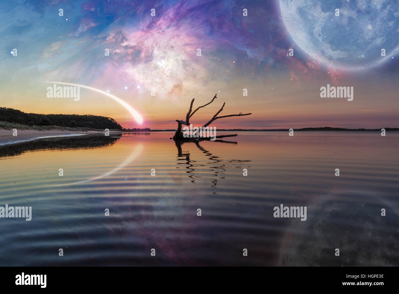 Fantasy landscape with driftwood reflecting in the water, huge planet in the sky, galaxy and comet. Elements of - Stock Image