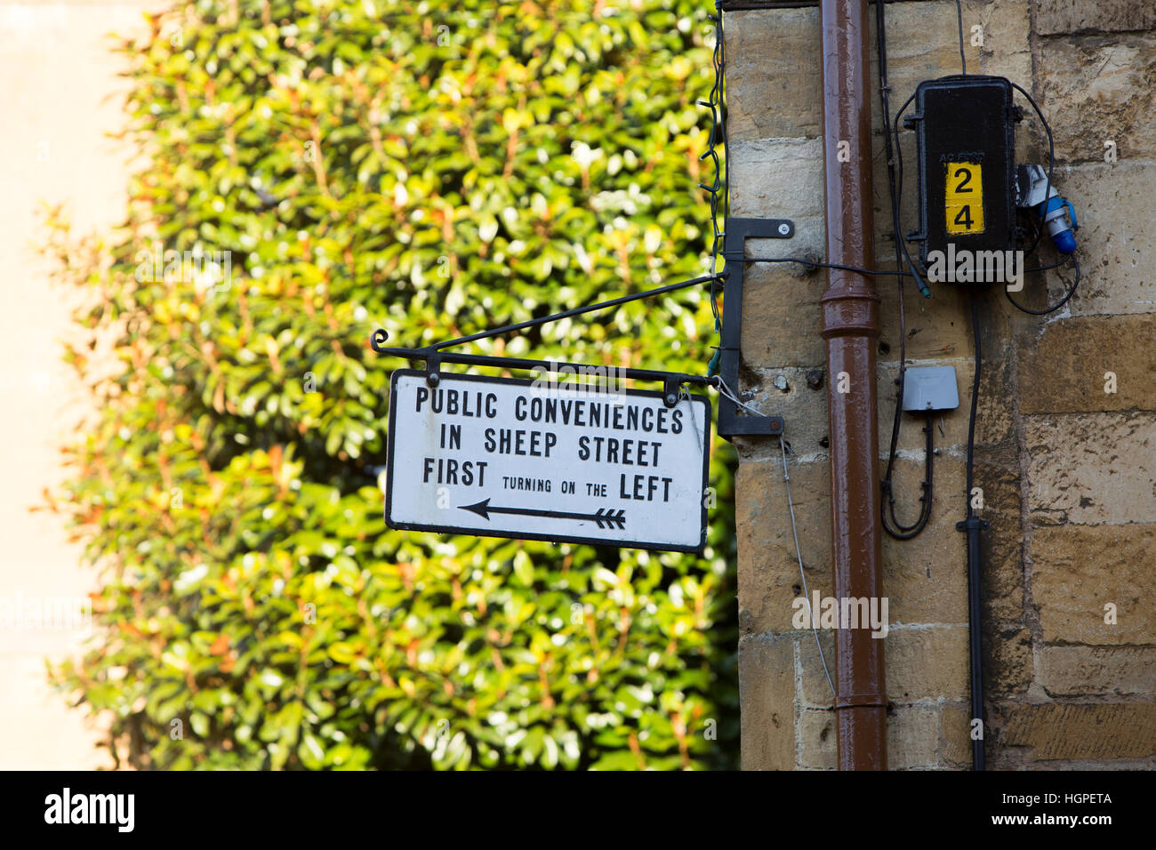 sign for public conveniences toilets in Chipping Campden high street, market town in the Cotswolds,Gloucestershire,England - Stock Image