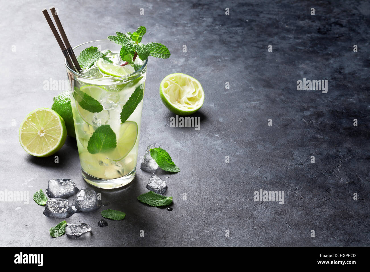 Mojito cocktail on dark stone table. With space for your text - Stock Image