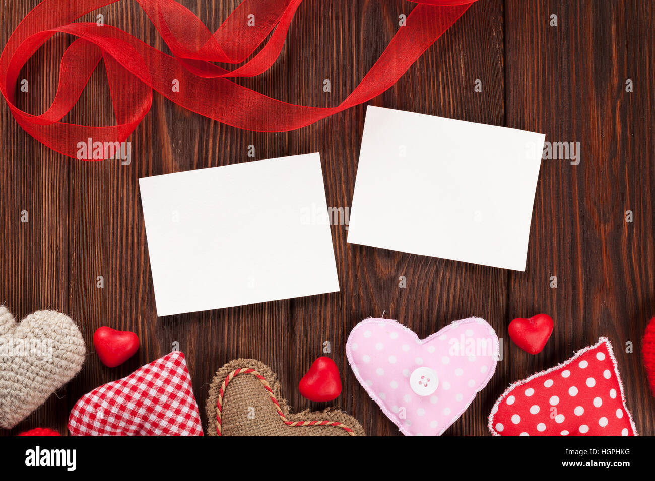 Valentines day photo frames and candy hearts over wooden table. Top ...