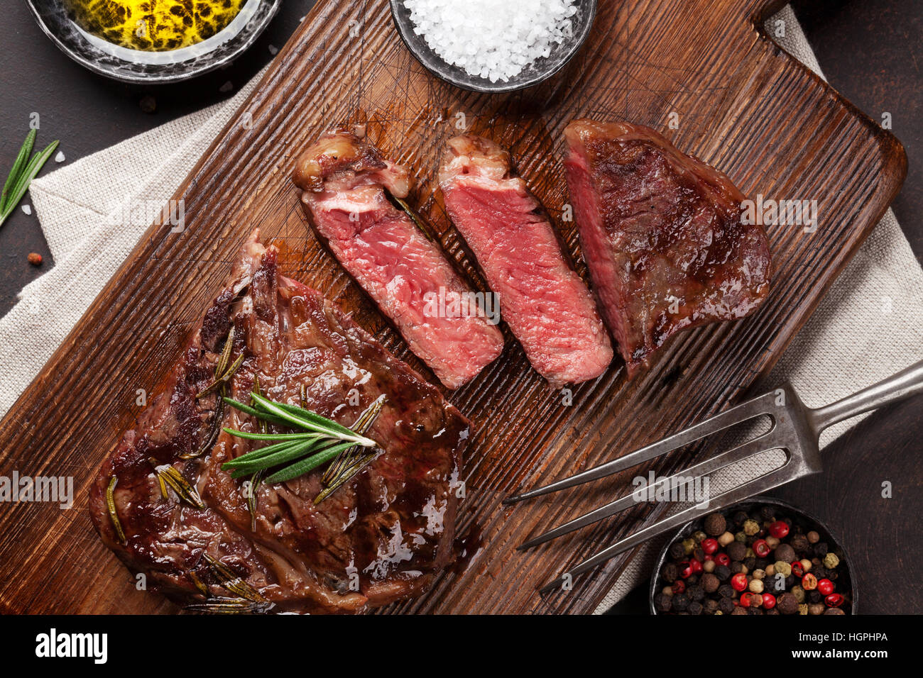 Grilled ribeye beef steak, herbs and spices. Top view Stock Photo