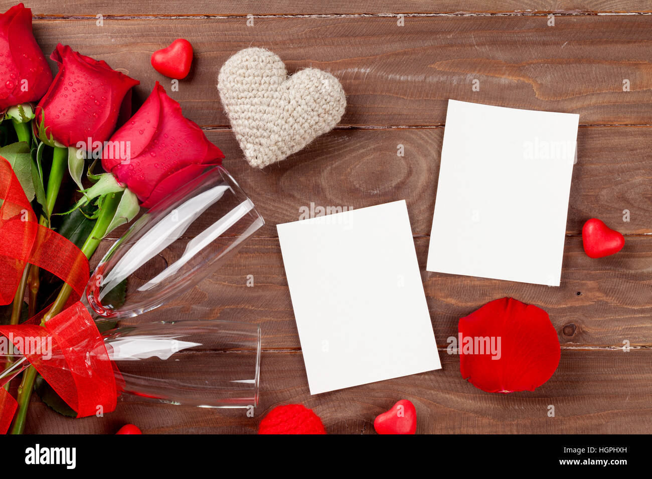 Valentines day rose bouquet, blank photo frames and champagne ...