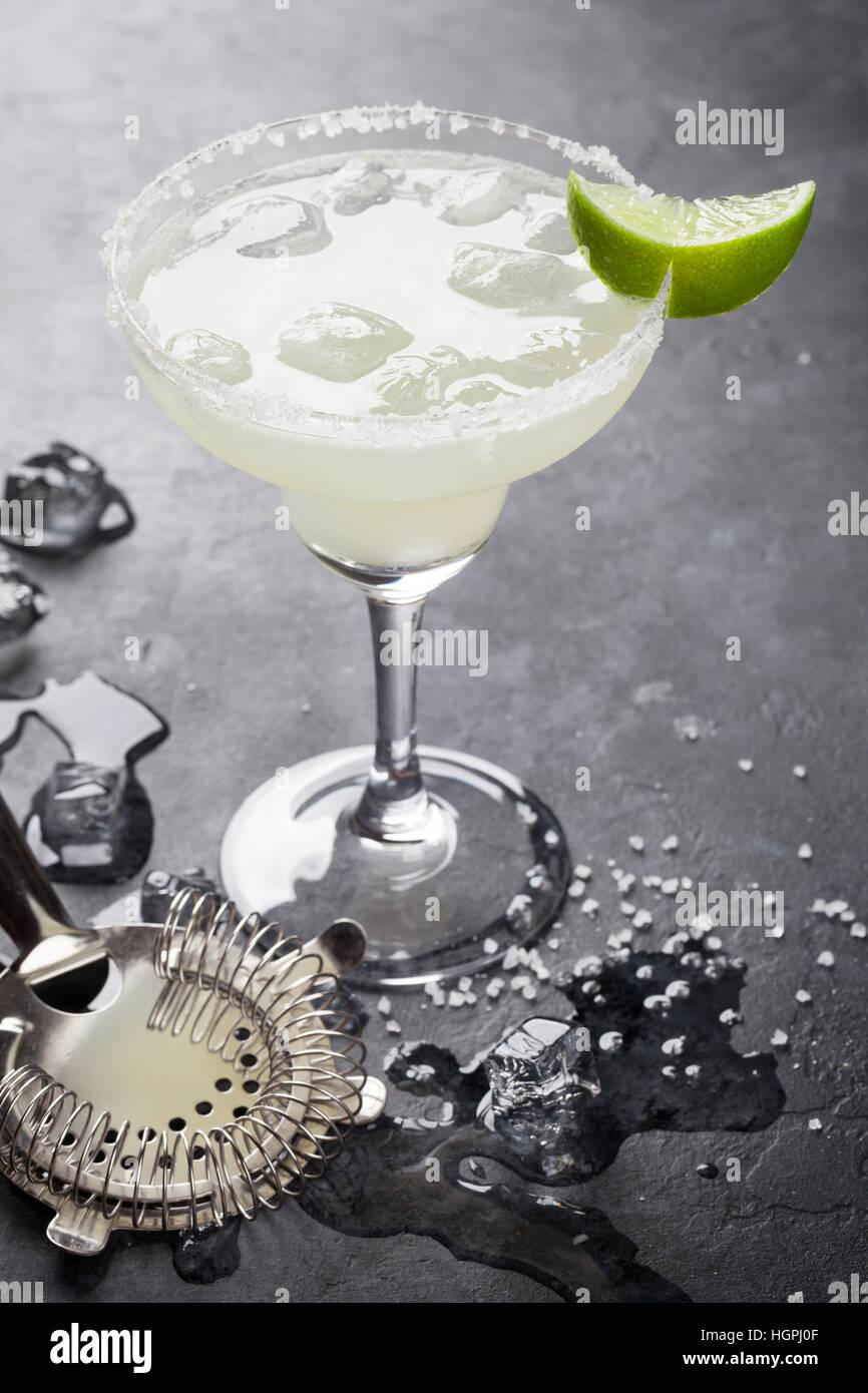 Margarita cocktail on dark stone table - Stock Image
