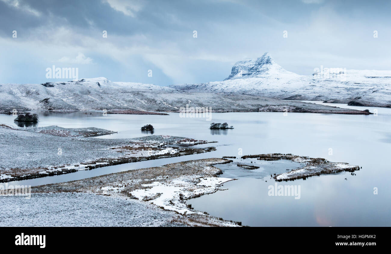 Suilven reflected in the waters of cam loch with thundersnow on the route of the north coast 500, Assynt, Elphin, - Stock Image