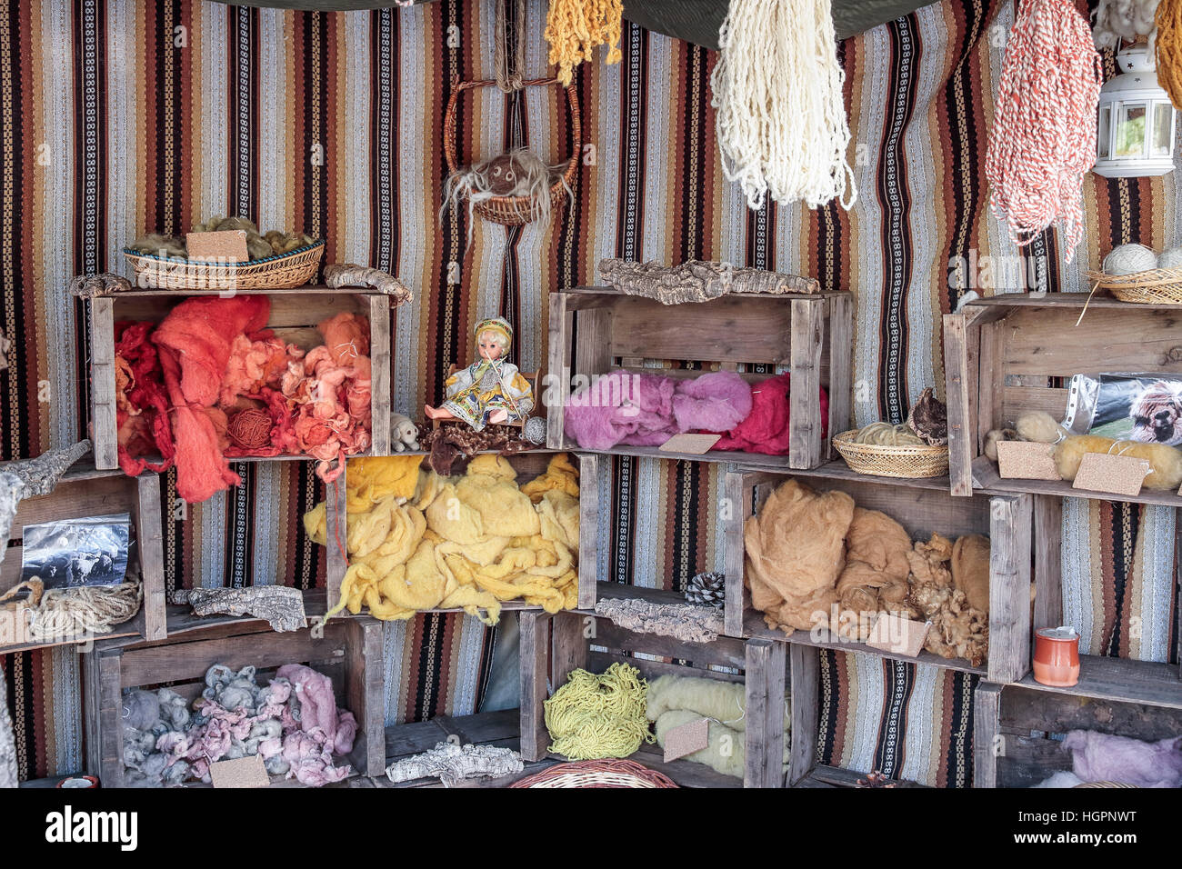 exhibition of some colored wool skeins dyed within wooden boxes - Stock Image