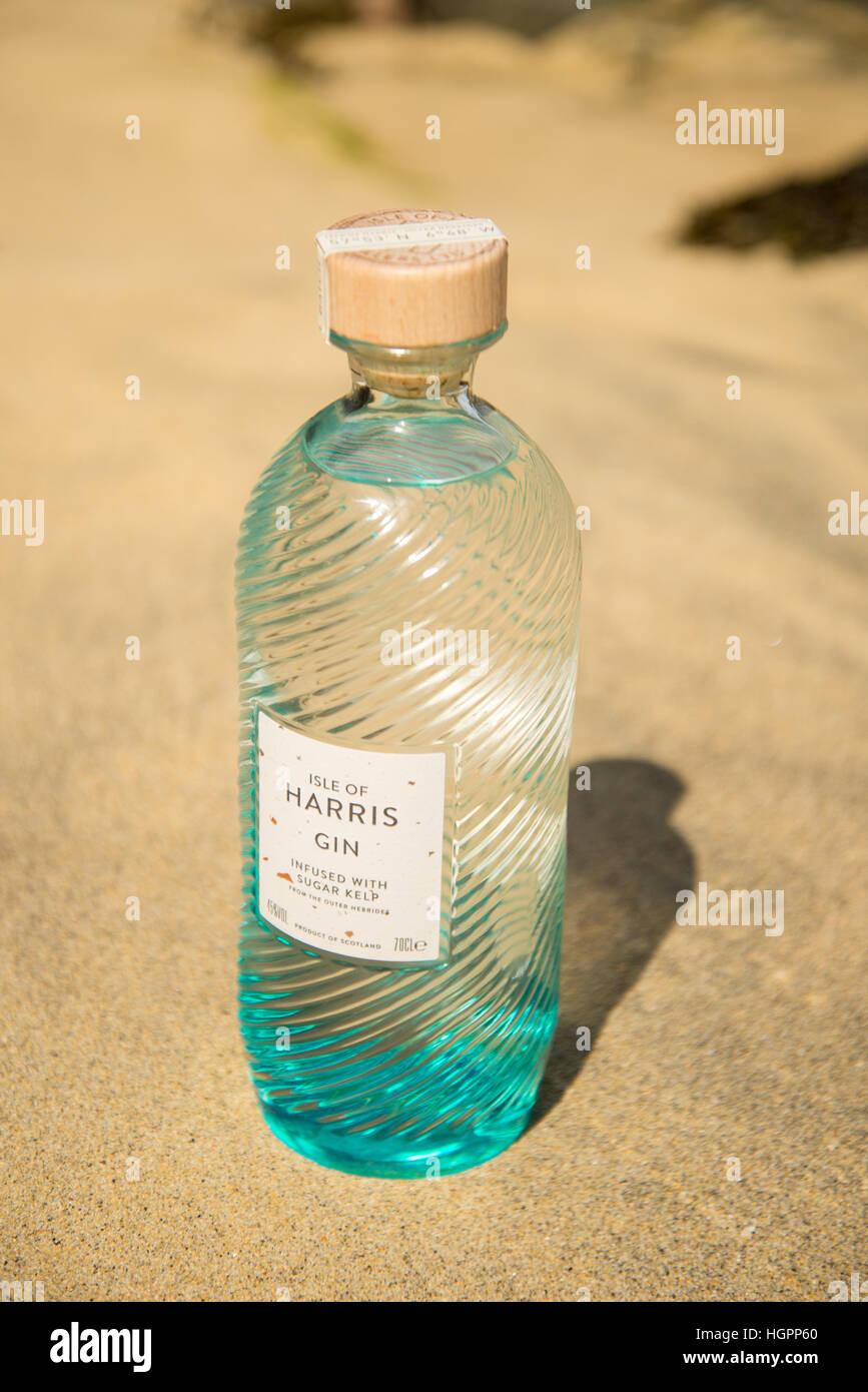 Bottle of Isle of Harris gin on hebridean beach of Traigh Iar, Isle of Harris, Outer Hebrides, scotland. - Stock Image