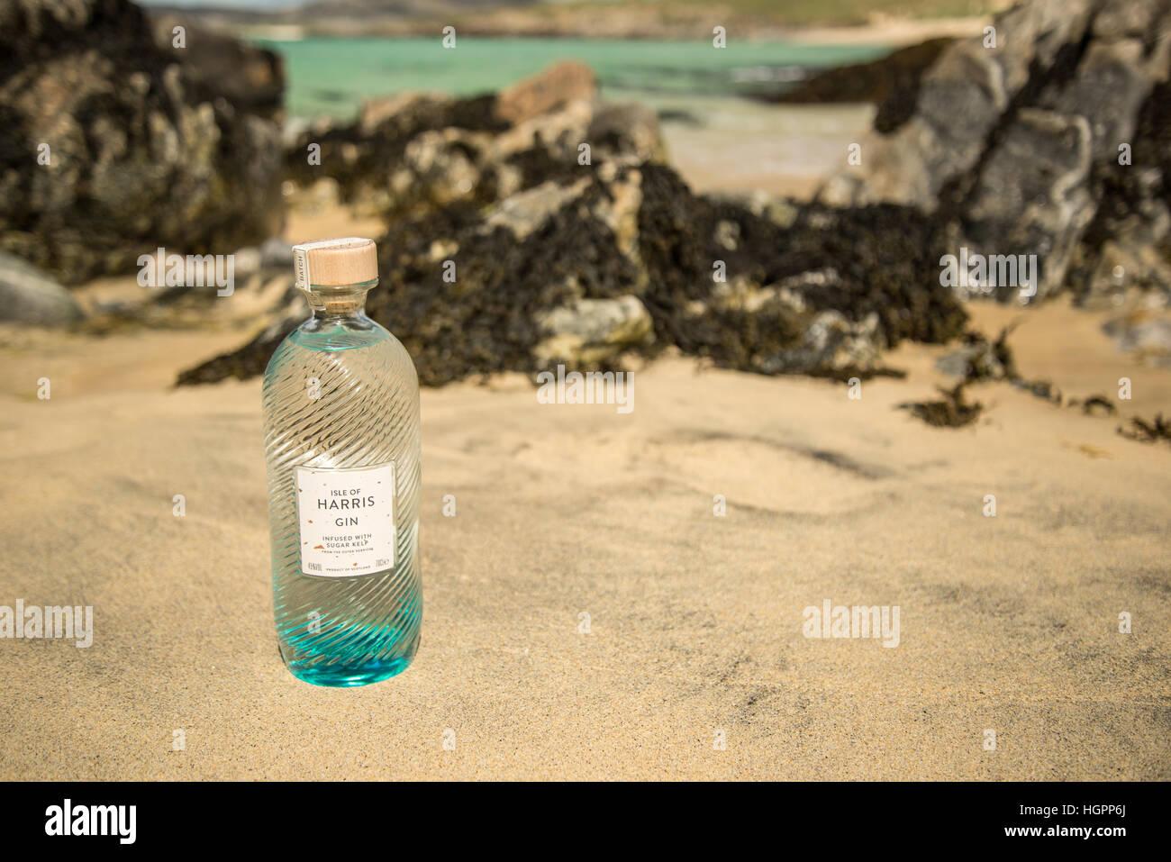 Bottle of Isle of Harris gin on hebridean beach of Traigh Iar, Isle of Harris, Outer Hebrides, scotland. Stock Photo