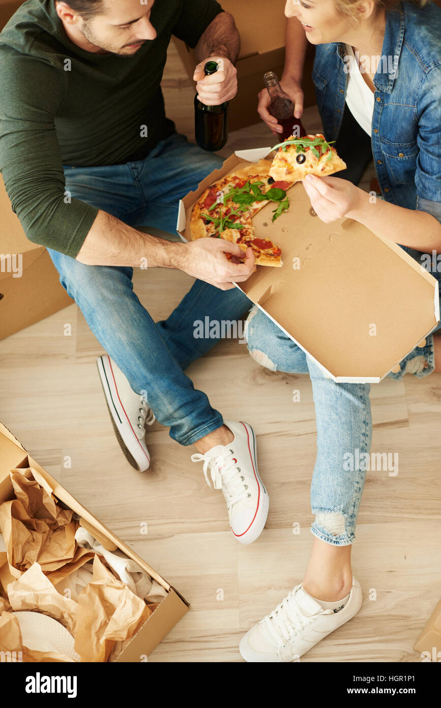 Directly above shot of eating couple - Stock Image