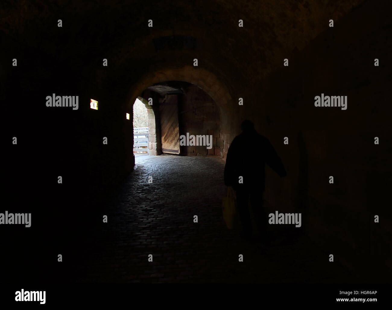 A shadowy figure in a tunnel - Stock Image