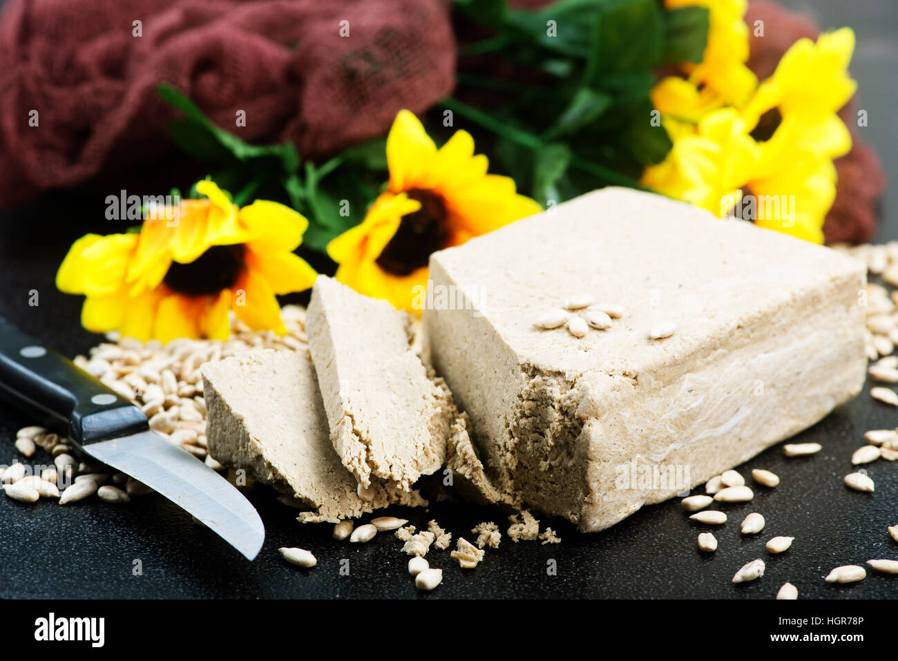 halva on plate and on a table - Stock Image