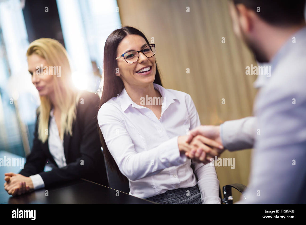 Business people agreement during board meeting in office - Stock Image