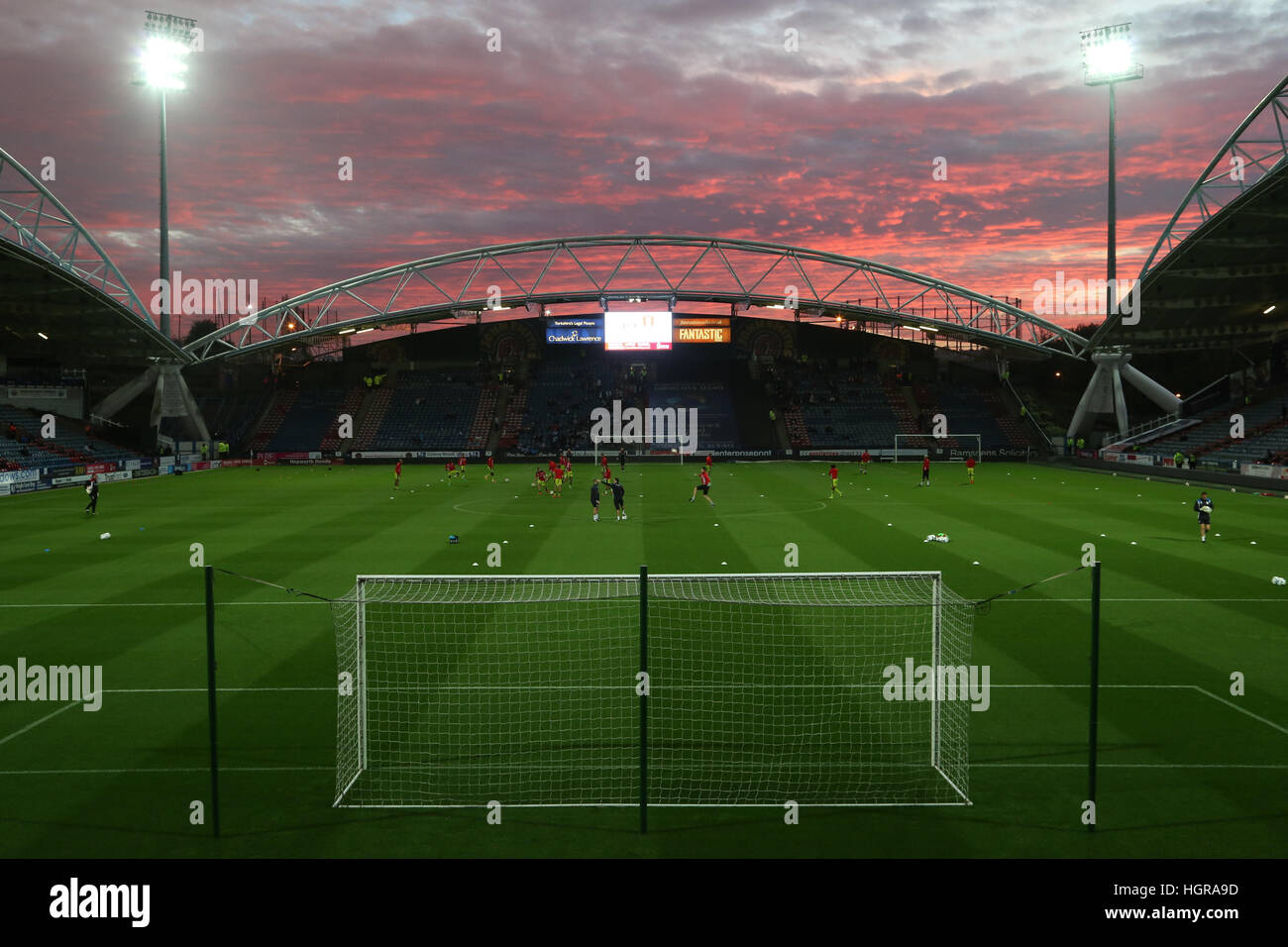 The sun sets over the John Smith's Stadium in Huddersfield before kick off in the Sky Bet Championship tie between - Stock Image