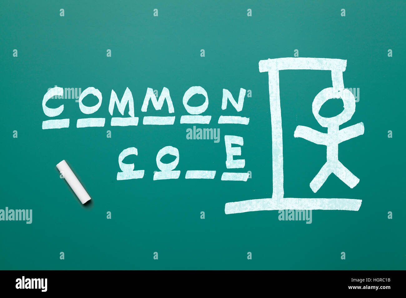 Common Core Hang Man on Green Chalk Board Isolated on White Background. - Stock Image