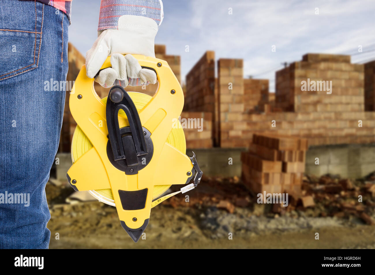Closeup view of measuring roulette kit in engineer hand as outdoor construction concept with copyspace - Stock Image