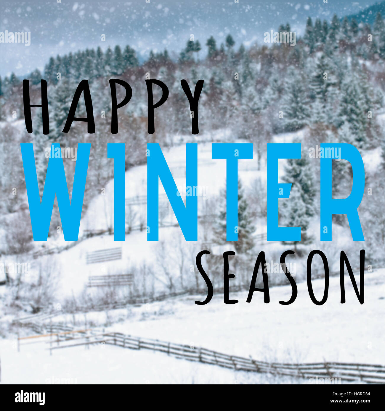 Happy winter season quote on blurred background with snow - Stock Image