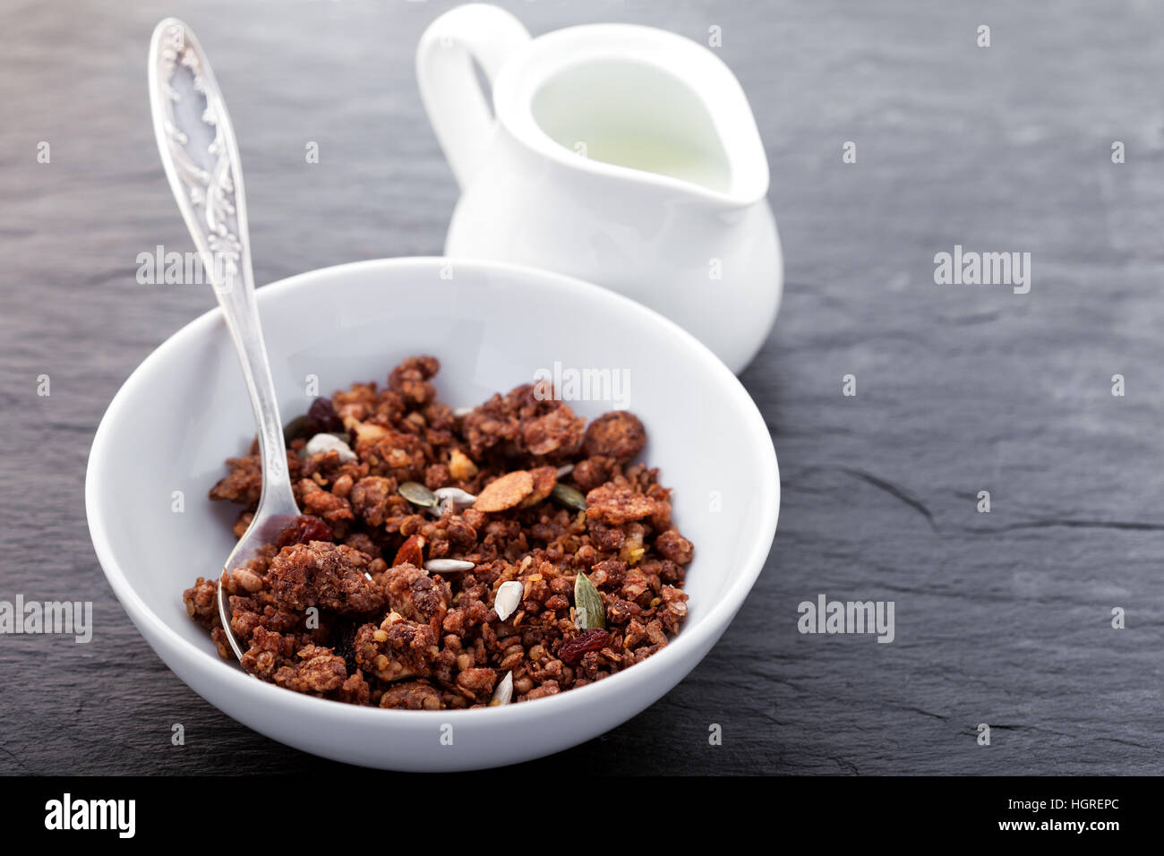 Granola - Healthy Chocolate Oat Bars in a white plate. - Stock Image