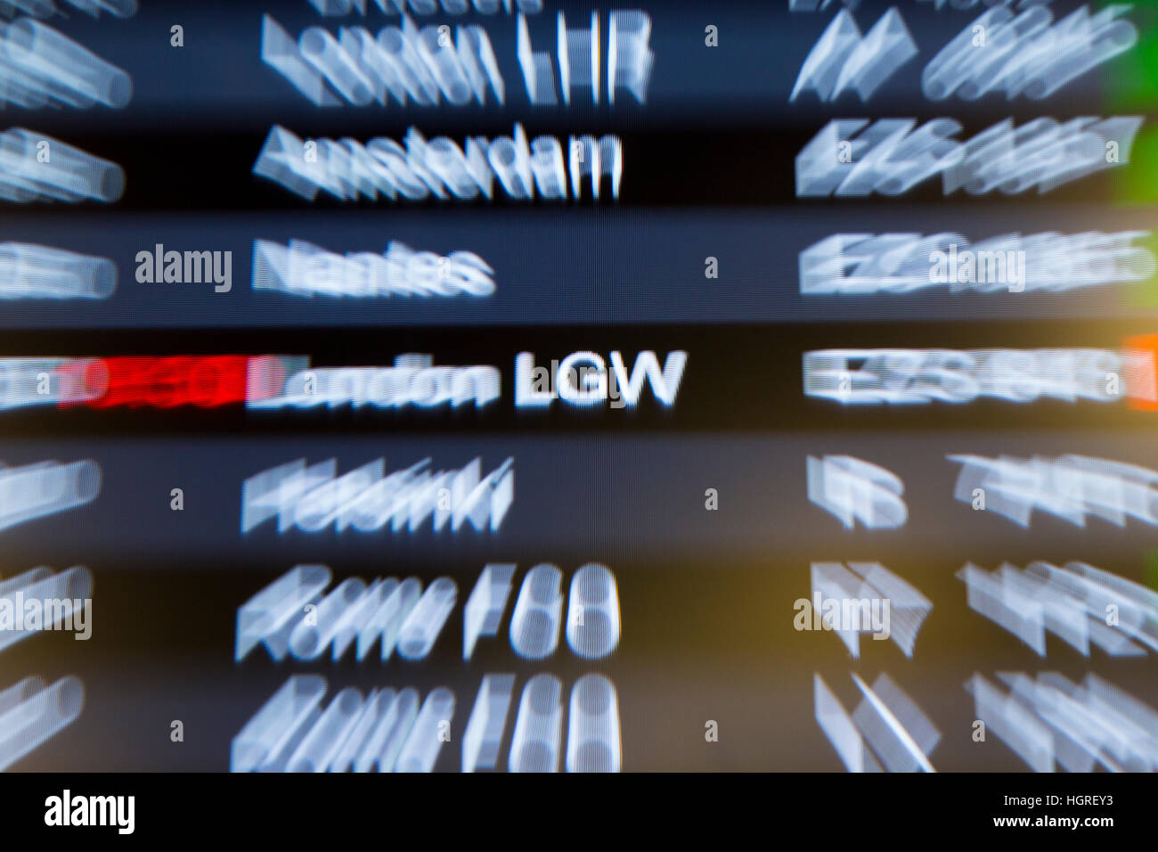 Flight departure information display screen in the departure lounge of London Gatwick LGW international airport. - Stock Image