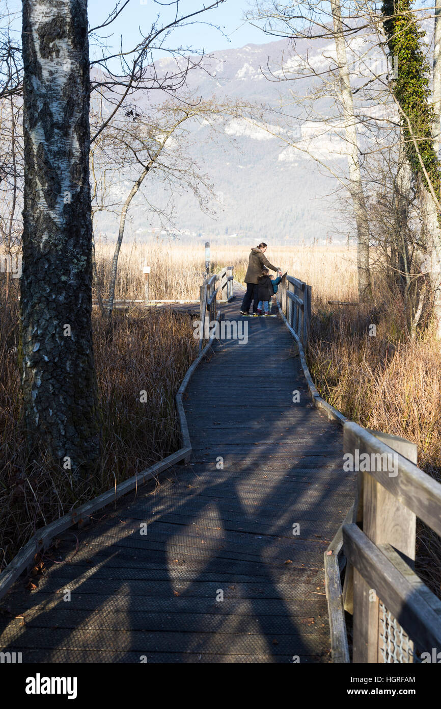 Tourist family & view of Marais de Lavours National Nature Reserve, Ain, France. French pre - Alps mountain - Stock Image