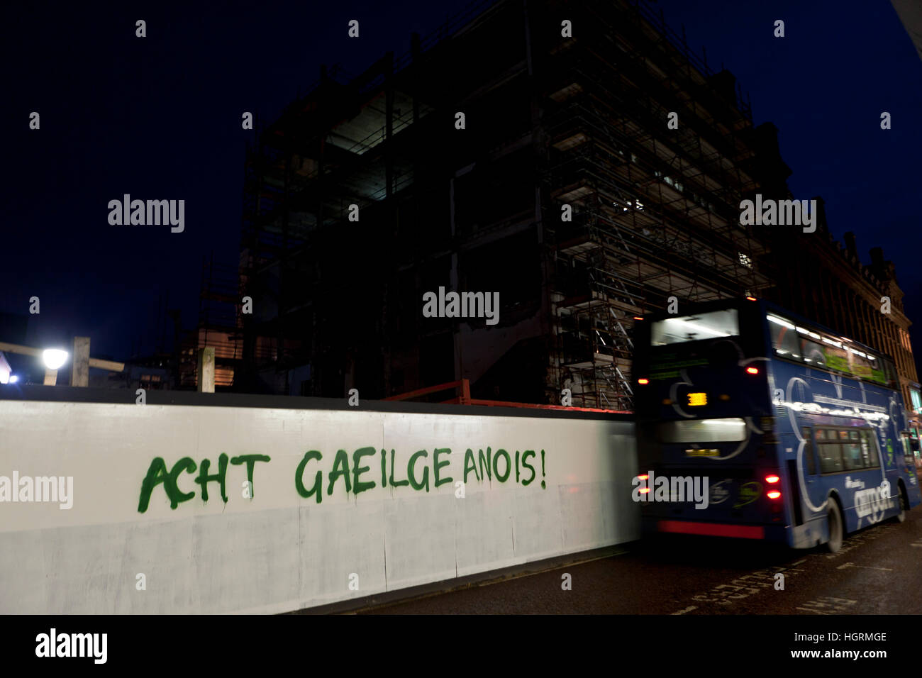 Castle Street, Belfast, UK. 12th Jan, 2017. A new piece of graffiti on a Building site hording has appeared. according - Stock Image