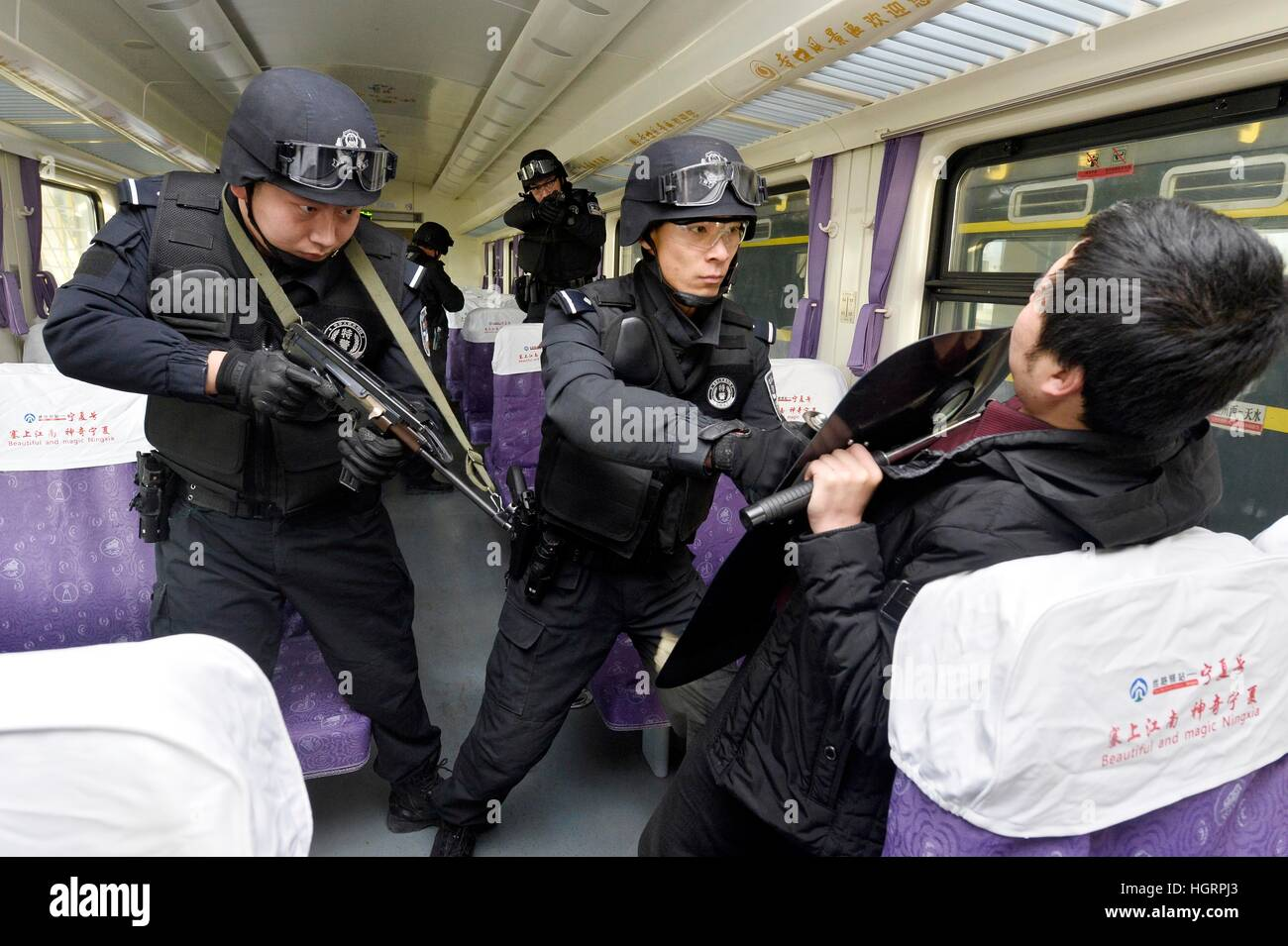 Beijing, China's Ningxia Hui Autonomous Region. 12th Jan, 2017. SWAT policement take part in an anti-riot exercise in a rail yard of the Yinchuan department of Lanzhou Railway Bureau in Yinchuan, capital of northwest China's Ningxia Hui Autonomous Region, Jan. 12, 2017. The exercise was held to improve security capacity for the upcoming Spring Festival travel rush. © Peng Zhaozhi/Xinhua/Alamy Live News Stock Photo