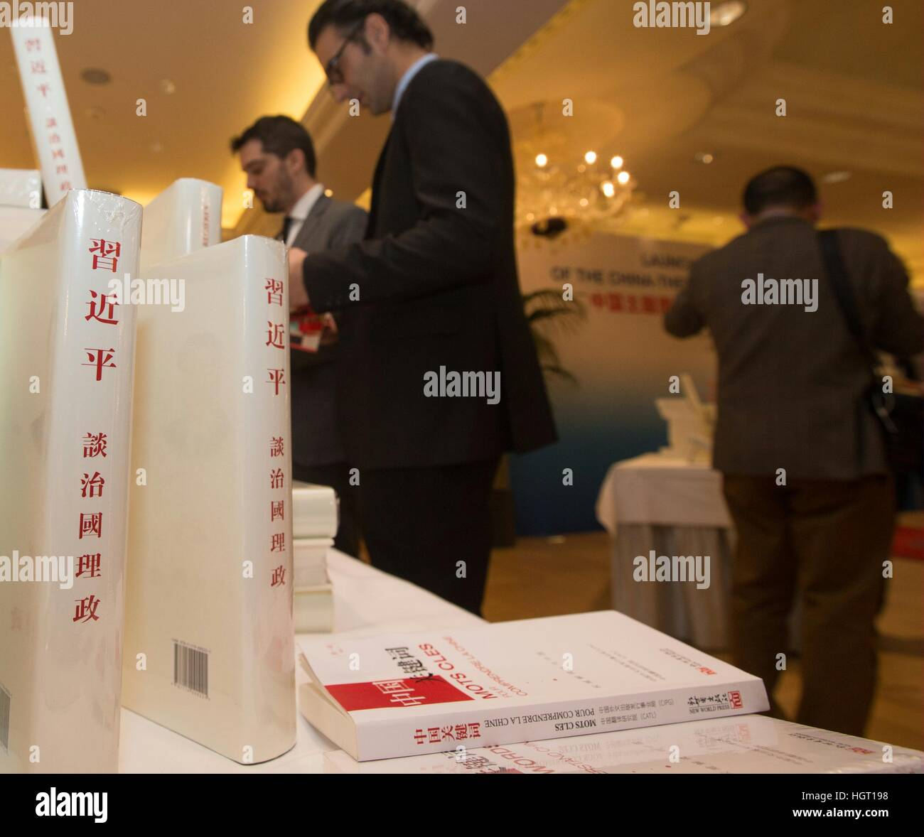 "Geneva, Switzerland. 9th Jan, 2017. Guests read Chinese President Xi Jinping's book ""Xi Jinping: the Governance Stock Photo"