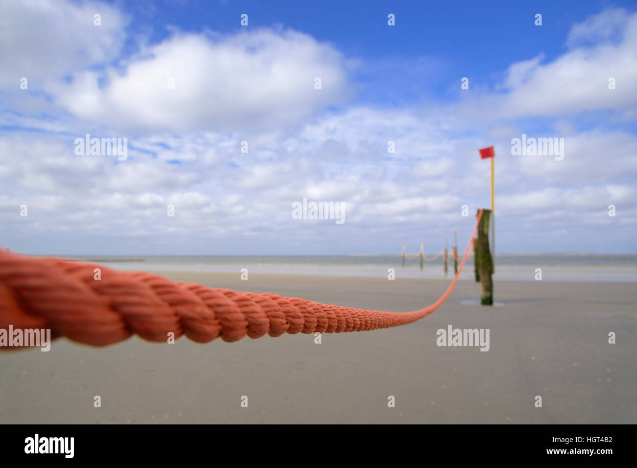 Orange barricade rope guarding bathing area, Norderney, East Frisian Islands, North Sea, Lower Saxony, Germany - Stock Image