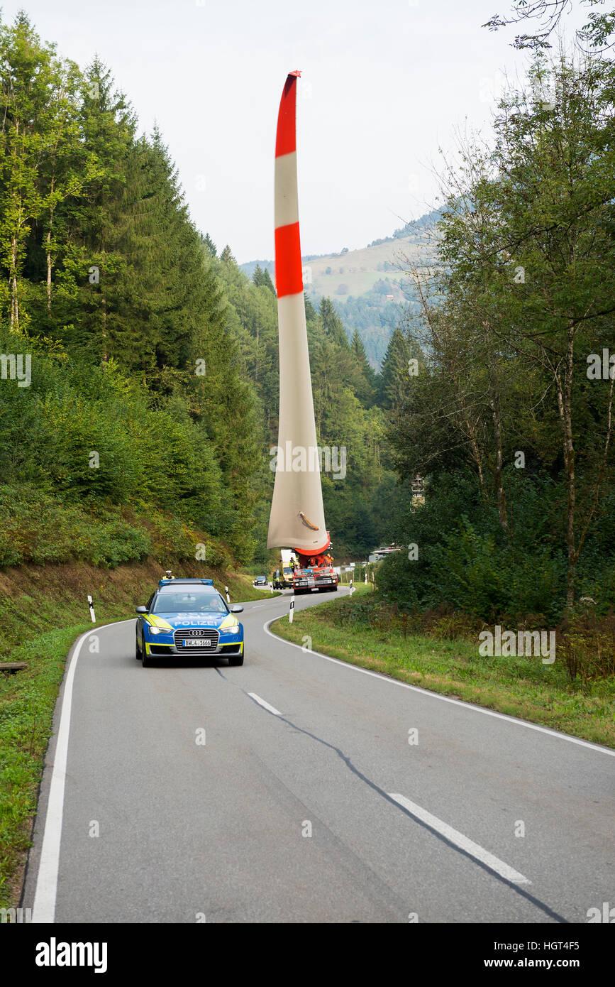 Heavy transport, wind turbine blade on heavy goods vehicle, curvy road in Schönau, Black Forest, Baden-Württemberg, - Stock Image