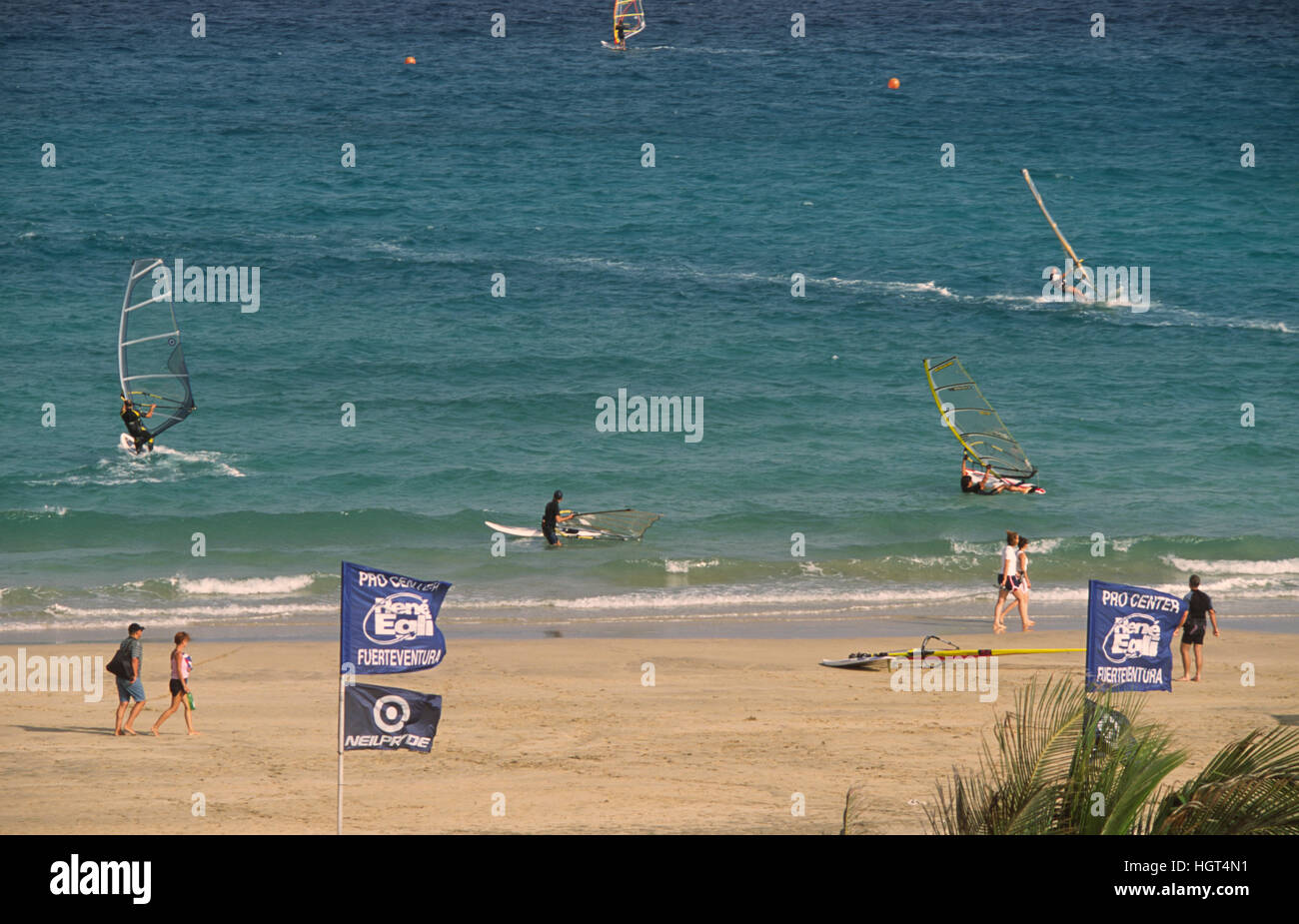 Surfers on the Costa Calma, Playa Barca, Fuerteventura, Canary Islands, Spain - Stock Image