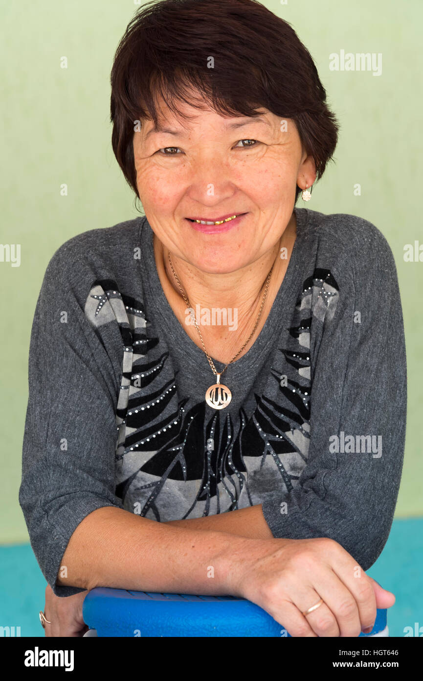 Kazakh woman behind her stall of goat cheese and kumis, Altyn Emel National Park, Almaty Province, Kazakhstan, Central - Stock Image