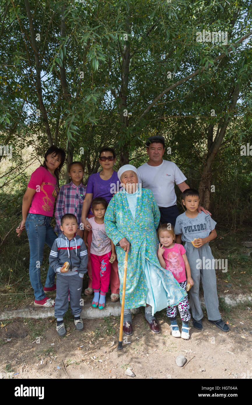 Kazakh family with children and an elderly woman, Altyn Emel National Park, Almaty Province, Kazakhstan, Central - Stock Image